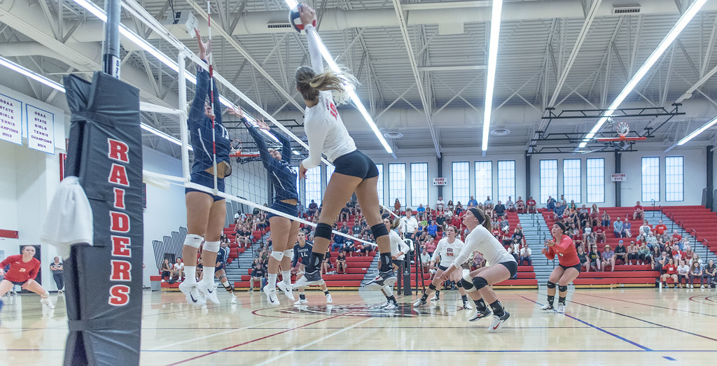 The outside hitters use their speed combined with their high vertical jumping ability to score points against the defense. (Al Case)