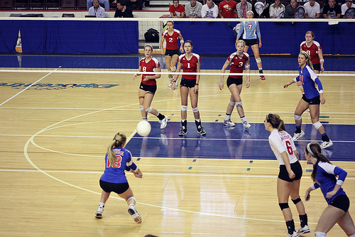 How To pass a volleyball: Keep knees bent in a loaded position and shoulders over knees when passing the ball so you move quickly in any direction to receive the serve. (Photo by AJ Bullock)