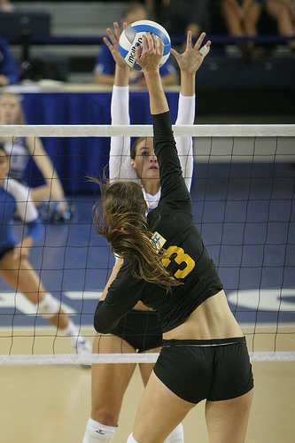 Blocker Watching The Hitter As She Block Jumps  Photo by White and Blue Review