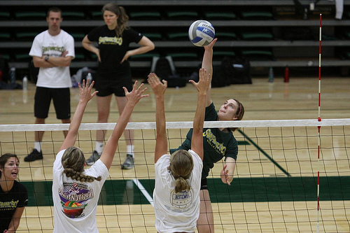 Volleyball Attacking: if you choose to hit the ball hard, after taking your spike approach to the ball and jumping in the air to hit it, that's called a spike. (Shaun Calhoun)